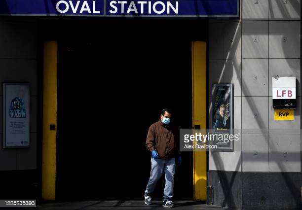 A member of the public wearing a protective mask walks out of Oval Station on May 16 2020 in London England The prime minister announced the general...