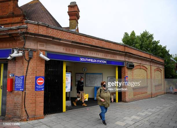 A member of the public wearing a protective mask walks out of Southfields Station on June 29 2020 in Wimbledon England The Wimbledon Tennis...