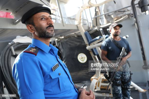 A member of the Qatari navy is seen inside a vessel during a joint military exercise between Qatar and the US navy in Doha on June 16 2017 The United...