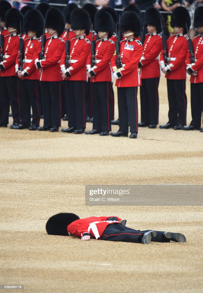 A member of the Queens Guard collapses during the Trooping the Colour, this year marking the Queen's 90th birthday at The Mall on June 11, 2016 in London, England. The ceremony is Queen Elizabeth II's annual birthday parade and dates back to the time of Charles II in the 17th Century when the Colours of a regiment were used as a rallying point in battle.