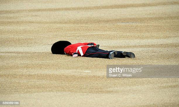 Member of the Queens Guard collapses during the Trooping the Colour, this year marking the Queen's 90th birthday at The Mall on June 11, 2016 in...
