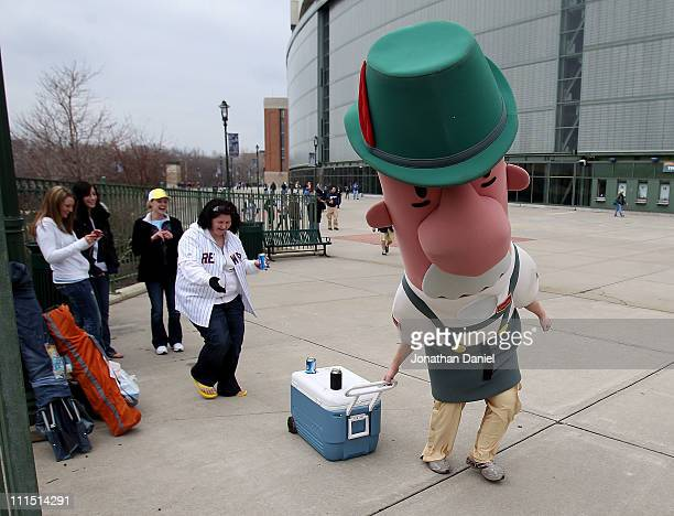 A member of the racing sausages steals a cooler from fans before the home opener between the Atlanta Braves and the Milwaukee Brewers at Miller Park...