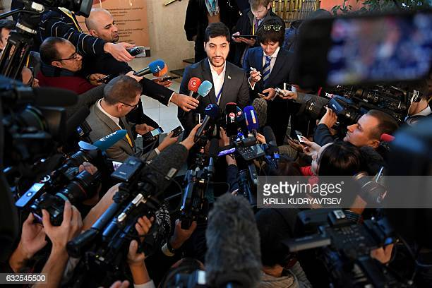 A member of the rebel delegation Osama Abu Zeid speaks to the media during the second day of Syria peace talks at Astana's Rixos President Hotel on...