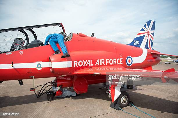 Member of the Red Arrows ground crew makes checks during the Royal International Air Tattoo at RAF Fairford on July 12, 2014 in Fairford, England....