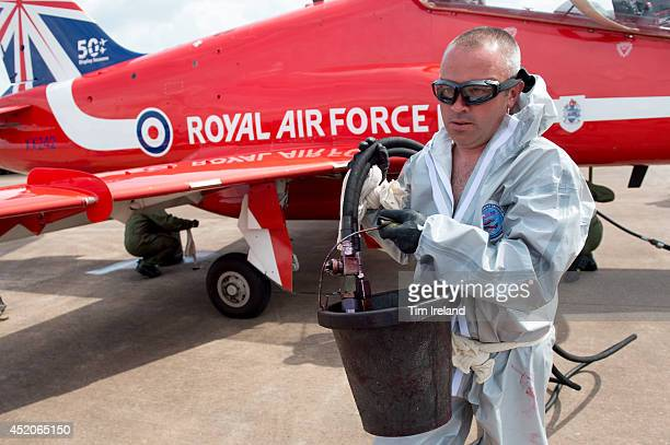 Member of the Red Arrows ground crew makes refills the smoke tanks during the Royal International Air Tattoo at RAF Fairford on July 12, 2014 in...