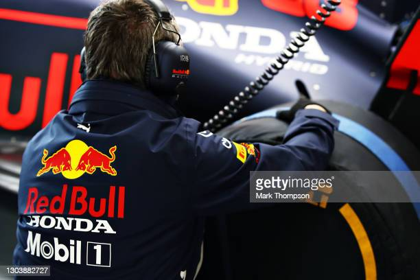 Member of the Red Bull Racing team works in the garage during the Red Bull Racing Filming Day at Silverstone on February 24, 2021 in Northampton,...