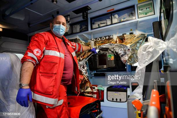 Member of the Red Cross at works during the nationwide lockdown on April 18, 2020 in Turin, Italy. The Italian government continues to enforce...