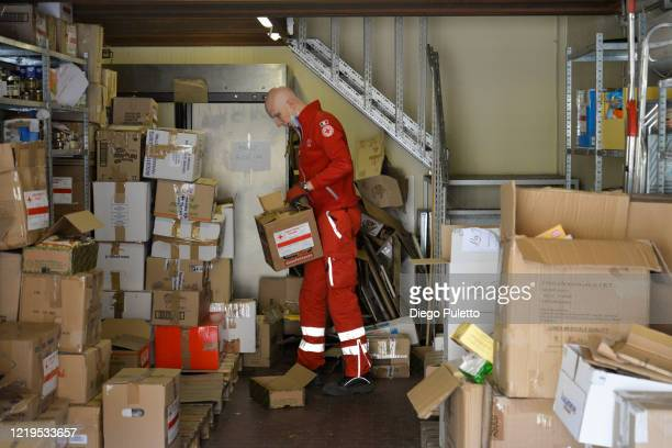 Member of the Red Cross delivers food to people who have financial difficulties during the nationwide lockdown caused by the coronavirus pandemic on...