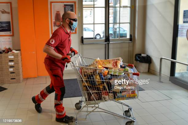 A member of the Red Cross delivers food to people who have suffered financial difficulties during the nationwide lockdown caused by the coronavirus...