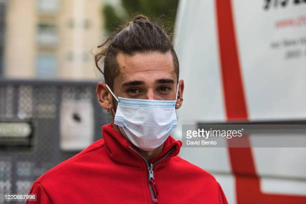 A member of the Red Cross looks on after making a transfer of a positive for coronavirus on April 23 2020 in Madrid Spain Starting last week some...