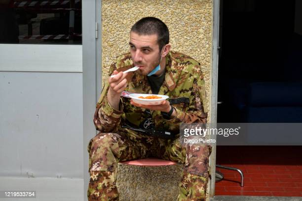 Member of the Red Cross Military during the nationwide lockdown caused by the Coronavirus pandemic on April 18, 2020 in Turin, Italy. The Italian...