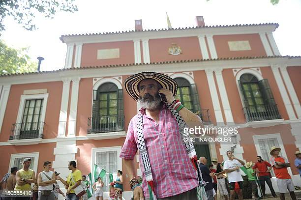 Member of the regional parliament for the United Left party in Andalucia Juan Manuel Sanchez Gordillo speaks on a phone during a sitin designed to...