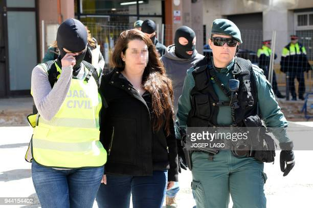 A member of the Republic Defence Committees radical separatist groups leaves her apartment building escorted by Spanish Guardia Civil guards in...