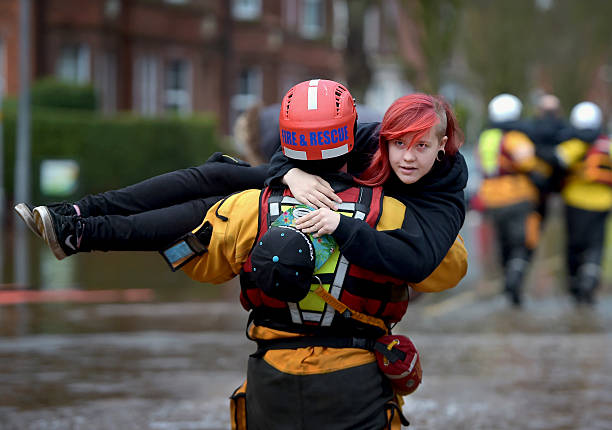 https://media.gettyimages.com/photos/member-of-the-rescue-team-carries-a-young-woman-to-safety-through-the-picture-id500283340?k=6&m=500283340&s=612x612&w=0&h=X-35CvVEwVuNdvhPz6Vt6IzrjDN1LLXwDCT2KnVuFwM=
