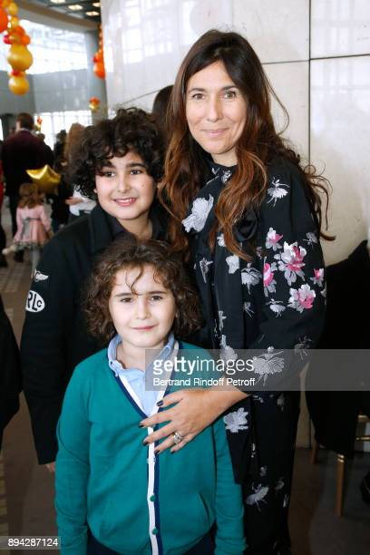 Member of the 'Reve d'enfants' committee Karine Journo with her sons Joachim and Eliott attend the 32th 'Reve d'Enfants' Charity Gala at Opera...