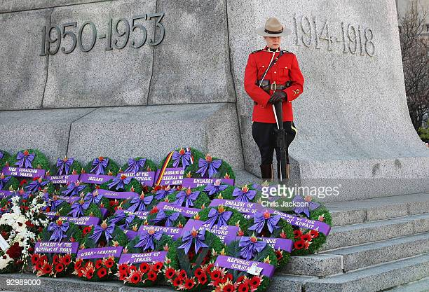 Member of the Royal Canadian Mounte Police stands on the National War Memorial during a Remembrance Day Service on November 11 2009 in Ottawa Canada...