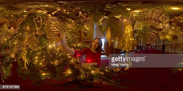 A member of the Royal Collection hangs a decoration on a 20ft Nordmann Fir tree from Windsor Great Park in the St George's Hall on November 23 2017...