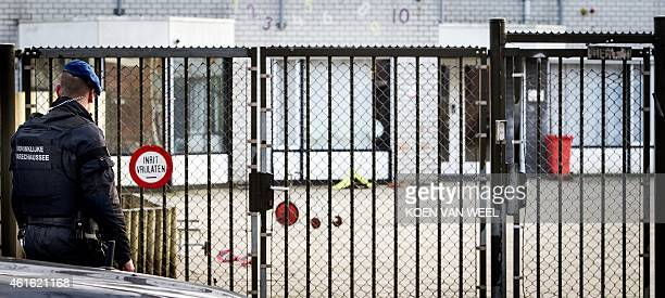 A member of the Royal Netherlands Marechaussee stands guard outside the Cheider school Netherlands' only Orthodox Jewish school in Amsterdam on...