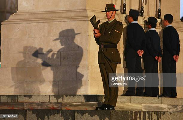 A member of the Royal New Zealand Army stands to attention at the corner of the Cenotaph during the Anzac day dawn service ceremony at the Auckland...