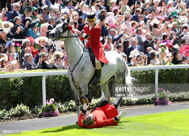 A member of the Royal procession gets knocked over by a horse during Royal Ascot Day 3 at Ascot Racecourse on June 21 2018 in Ascot United Kingdom