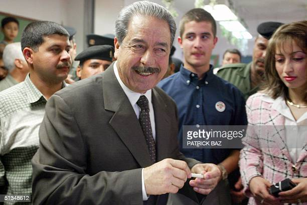 Member of the ruling Revolution Council Command and Iraqi President Saddam Hussein's cousin Ali Hasan alMajid smiles after casting his vote at a...