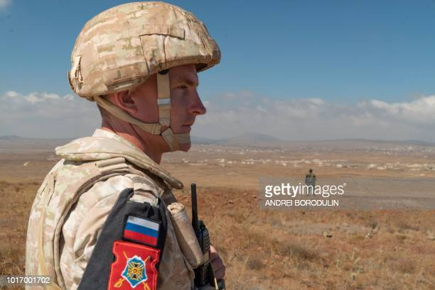 A member of the Russian military police patrols near the village of Tal Krum in the Syrian Golan Heights on August 14 2018
