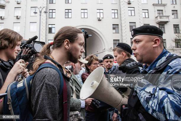 A member of the Russian military using a loudspeaker to read out messages to the protesters Anticorruption protest organised by opposition leader...