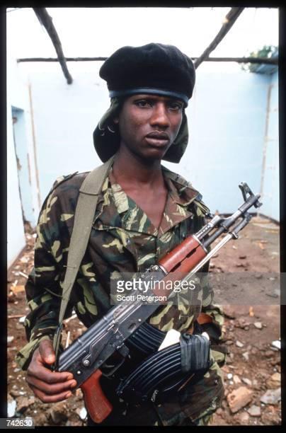A member of the Rwandan Patriotic Front rebel army poses May 25 1994 in Kigali Rwanda Following the assassination of President Juvenal Habyarimana in...