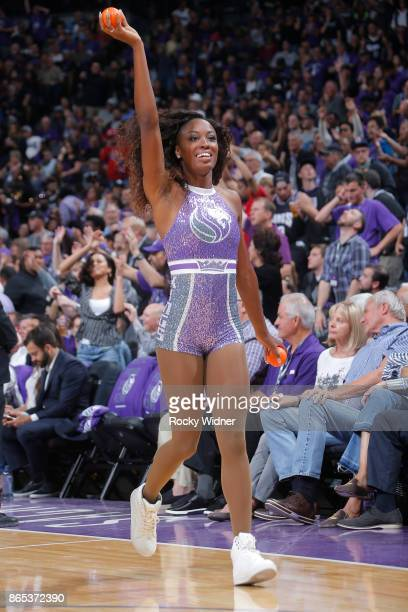 A member of the Sacramento Kings dance team hands out gifts to fans during the game against the Houston Rockets on October 18 2017 at Golden 1 Center...