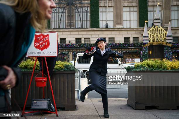 A member of the Salvation Army sings and dances along Fifth Avenue in Midtown Manhattan December 18 2017 in New York City The city is decked out in...