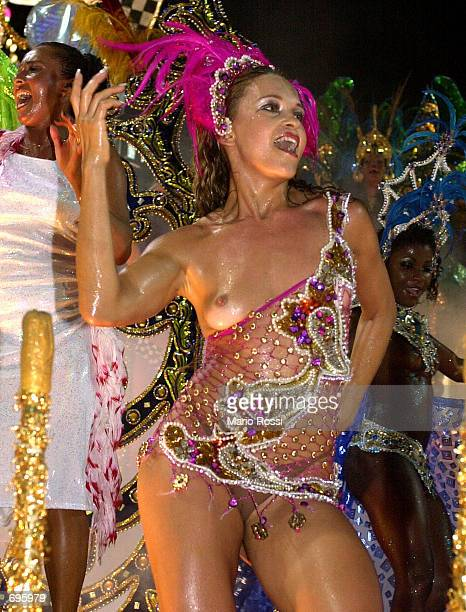 A member of the samba school Uniao da Ilha dances in the Carnival parade at the sambadrome February 10 2002 in Rio de Janeiro Brazil