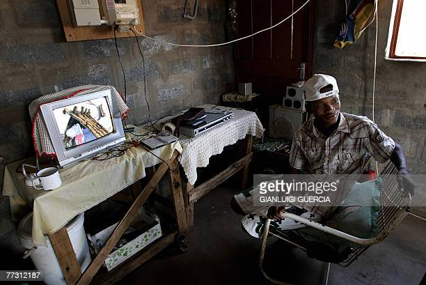 Member of the SAN community watches TV, 01 September 2007, at his house in the Platfontein SAN settlement on the outskirt of the Northern Cape' town...