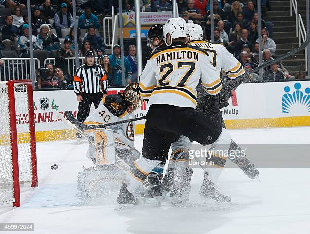 Member of the San Jose Sharks scores a goal against Dougie Hamilton and Tuukka Raask of the Boston Bruins during an NHL game on December 4, 2014 at...