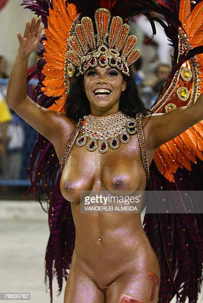 A member of the Sao Clemente samba school dances during the first night of the carnival parade at the Sambodrome in Rio de Janeiro on February 3 2008...