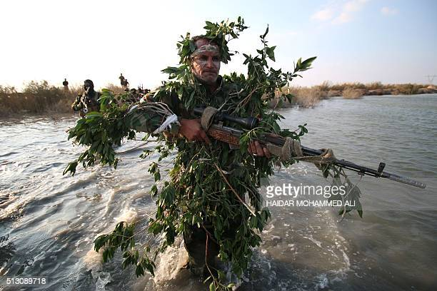 TOPSHOT A member of the Saraya alSalam a group formed by Iraqi Shiite Muslim cleric Moqtada alSadr takes part in a military training session in the...