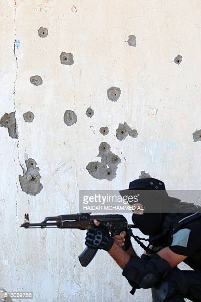 A member of the Saraya alSalam a group formed by Iraqi Shiite Muslim cleric Moqtada alSadr looks through the viewfinder of a weapon during a military...