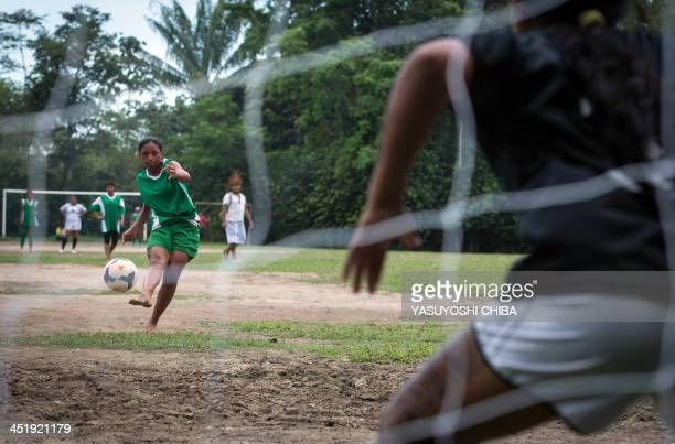A member of the Satere Mawe tribe shoots at the goal during the final match of Peladao the amateur football tournament in Manaus Amazonas state...
