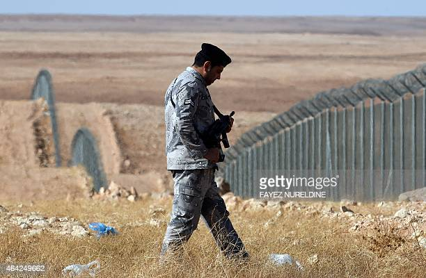 A member of the Saudi border guards forces patrols the fence on Saudi Arabia's northern border with Iraq near Arar City on February 23 2015 Saudi...