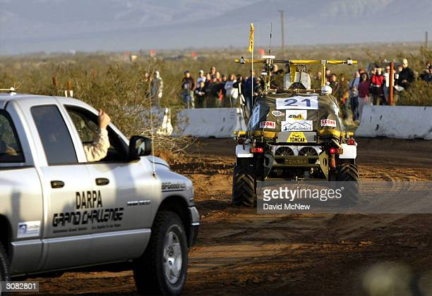 A member of the SciAutononics II team gives a thumbsup gesture from the chase vehicle as they follow their autonomous or unmanned vehicle from the...