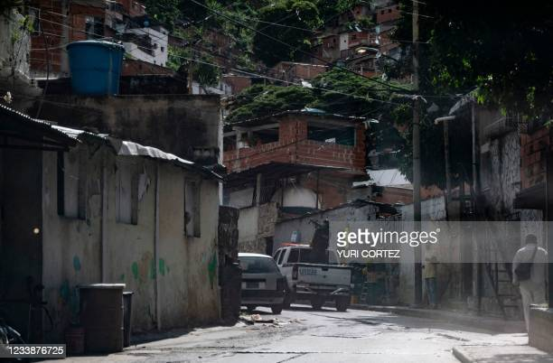 Member of the Scientific, Criminal and Forensic Investigations Corps aims his sub-machine gun while entering the neighborhood of El Valle in the...