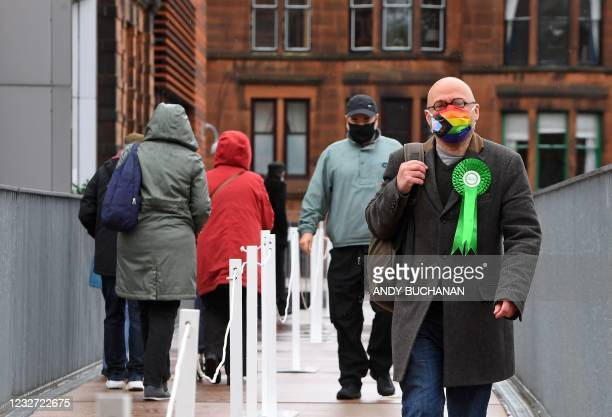 Member of the Scottish Parliament Patrick Harvie, co-leader of the Scottish Greens, follows a one-way queuing system as he arrives to vote at a...