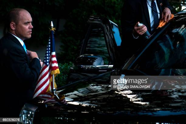 A member of the Secret Service cleans one of US President Donald Trump's armored limousines before departing the White House June 4 2017 in...