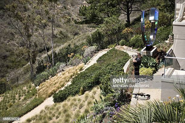 A member of the Secret Service counter sniper team looks out toward the Pacific Ocean during a fundraiser for the Democratic Congressional Campaign...