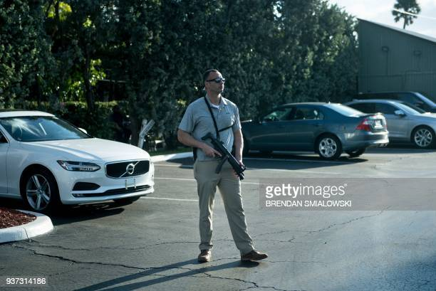 A member of the Secret Service stands guard at MaraLago while US President Donald Trump visits his property March 24 2018 in Palm Beach Florida / AFP...