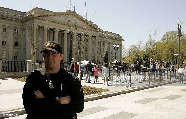 Member of the Secret Service stands guard near where a mallard duck is nesting in front of the U.S. Treasury building April 15, 2005 in Washington,...