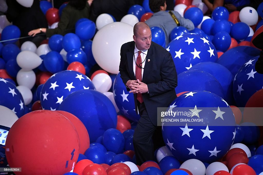 TOPSHOT - A member of the Secret Service stands in balloons after Democratic Presidential candidate Hillary Clinton delivered her acceptance speech at the 2016 Democratic National Convention July 28, 2016 in Philadelphia, Pennsylvania. / AFP / Brendan Smialowski
