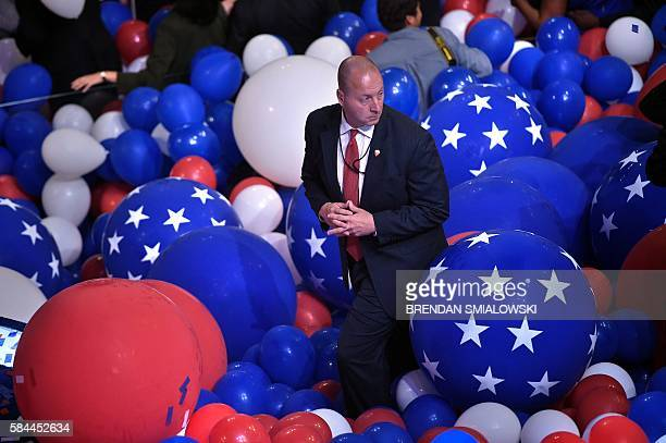 TOPSHOT A member of the Secret Service stands in balloons after Democratic Presidential candidate Hillary Clinton delivered her acceptance speech at...