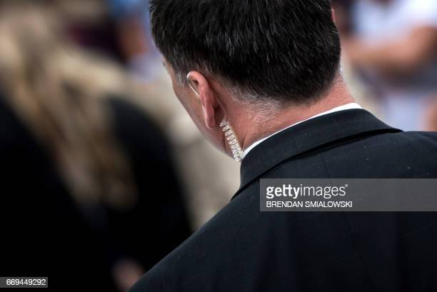A member of the Secret Service works during the Easter Egg Roll on the South Lawn of the White House April 17 2017 in Washington DC