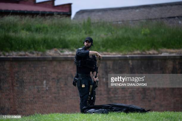Member of the Secret Service's counter sniper team packs up his rifle after the US president left a Memorial Day event at the Fort McHenry National...