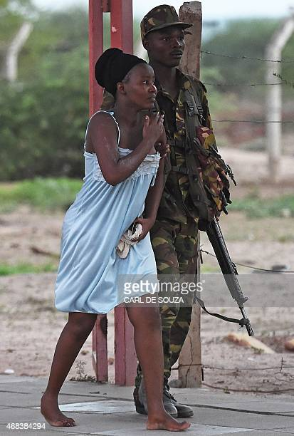 Member of the security forces escorts a student out of Garissa University campus on April 2 after an attack by Somalia's Al-Qaeda-linked Shebab...